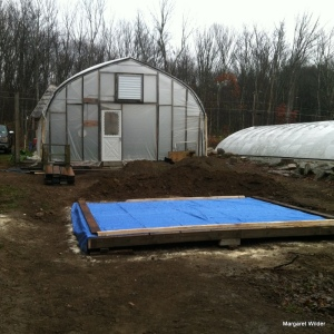 We started with the base in a sunny spot close to both greenhouses